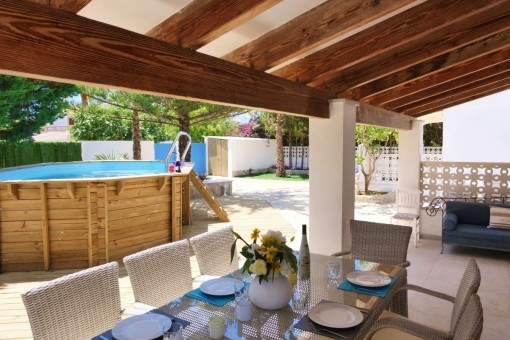 Covered dining area by the pool