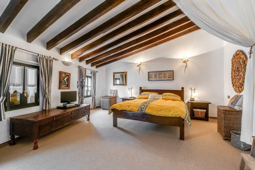 Bedroom with high ceiling