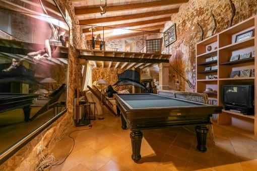 Rustic style room with billard