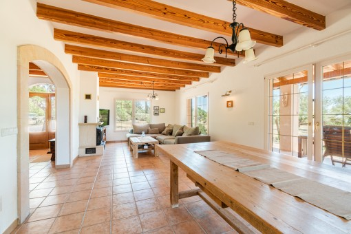 Spacious living and dining area with wooden ceiling beams