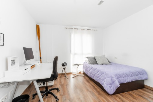 One of 2 bright bedrooms