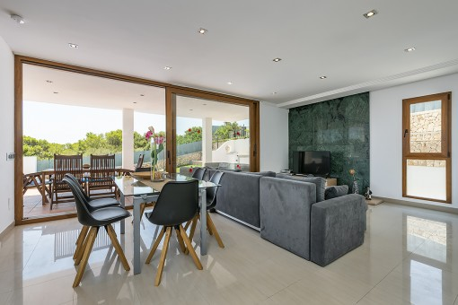 Living and dining area with direct terrace access