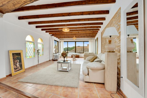 Living area with wooden ceiling beams
