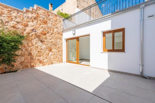 Patio with beautiful stone wall