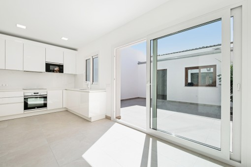 Bright kitchen with patio access