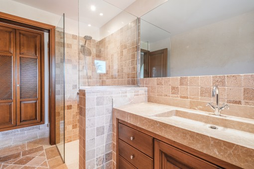 Mediterranean bathroom with shower