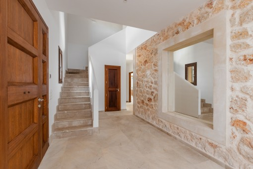Entrance hall with beautiful narural stone walle