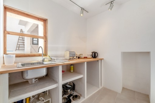 Bright, adjoining kitchen
