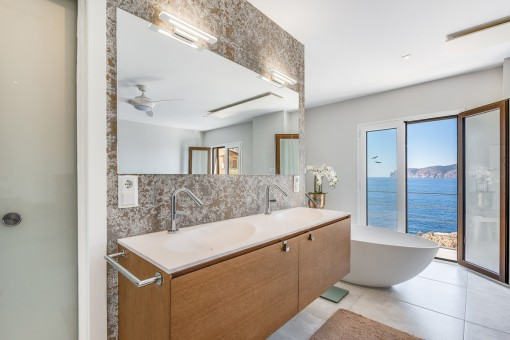 Open bathroom with bathtub and shower