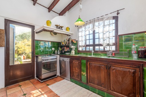 Rustic country house kitchen with terrace access