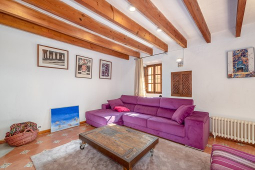 Beautiful living area with wooden ceiling beams