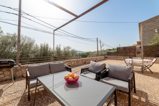 Large terrace with seating area