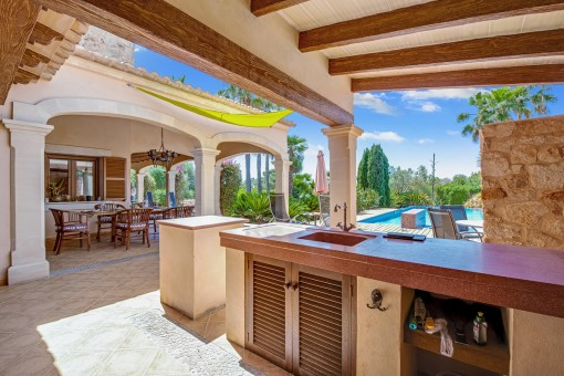 Summer outdoor kitchen next to the pool