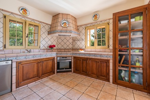 Large kitchen in country house style