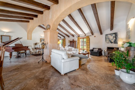 Large living area with stone arch
