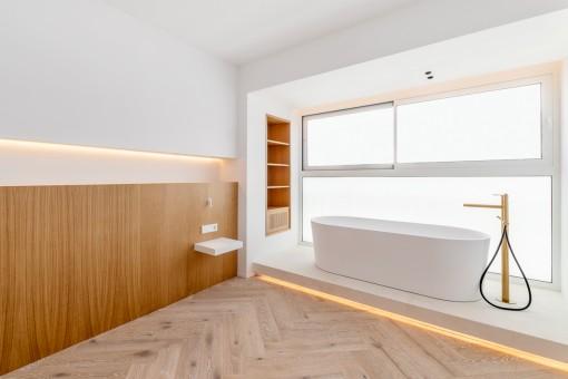 Bedroom with elegant bathtub