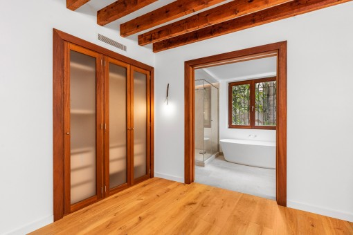 Beautiful bedroom with wooden ceiling beams