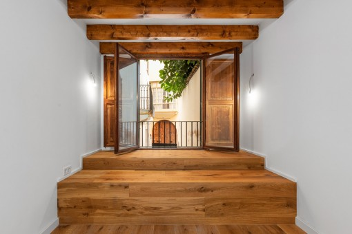 Wooden window to the main patio