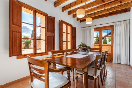 Bright dining area with wooden ceiling beams