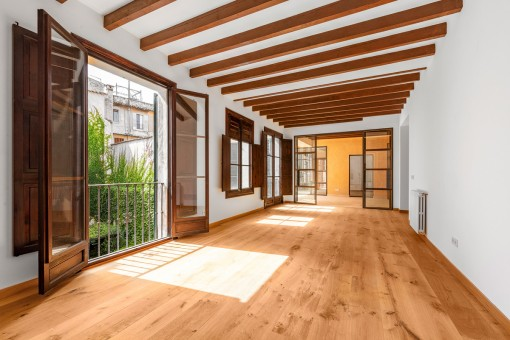 Second living area with wooden ceiling beams